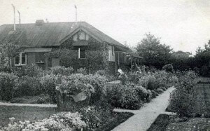 Bois Cottage c1905 with Henrietta Busk on the Porch